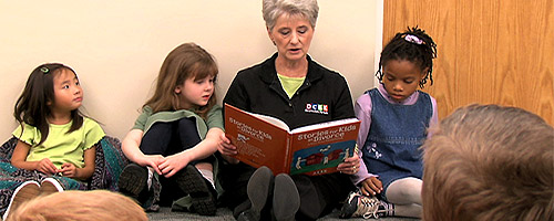 Leader reading to kids